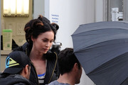 Brian Austin Green holds an umbrella to block Megan Fox as she exits her trailer on the set of 'Friends with Kids' in the Bronx.