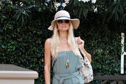 Paris and Nicky Hilton arrive at their hotel in Saint-Tropez.