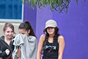 Vanessa Hudgens leaves a Studio City gym with her mother, Gina, and two friends. Vanessa holds her pants up to keep them dry in the rain.