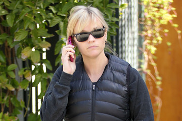 Reese Witherspoon Keeps Covered Up in a Vest