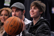 Singer Justin Bieber sits in the audience during the 2011 NBA All-Star game at Staples Center on February 20, 2011 in Los Angeles, California. NOTE TO USER: User expressly acknowledges and agrees that, by downloading and or using this photograph, User is consenting to the terms and conditions of the Getty Images License Agreement.