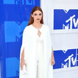 Holland Roden in a White Cape and Jumpsuit