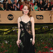 Emma Stone in a Draped Floral Bustier Dress