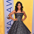 Gabby Douglas in a Metallic Strapless Dress