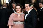 Actress Melissa McCarthy and guest arrive at the 84th Annual Academy Awards held at the Hollywood & Highland Center on February 26, 2012 in Hollywood, California.