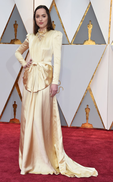 Dakota Johnson in a Gold Silk Gucci Gown