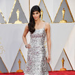 Sofia Boutella in a Sparkling Silver Gown with Feather Embellishments