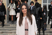 Mila Kunis attends the Christian Dior Ready-To-Wear Fall/Winter 2012 show as part of Paris Fashion Week at Musee Rodin on March 2, 2012 in Paris, France.