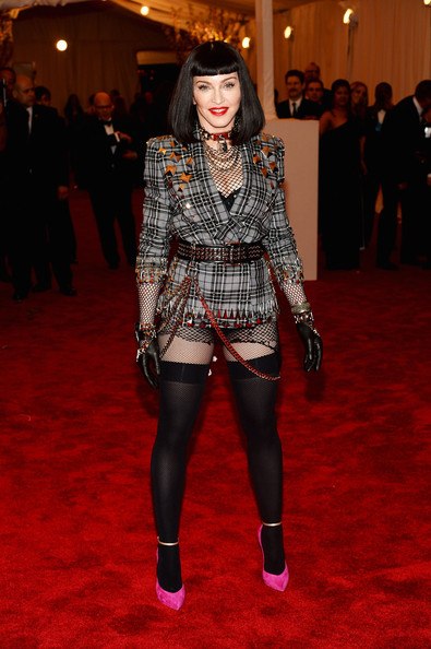 Rocking A Givenchy Plaid Blazer With Chains, Studs And Thigh-Highs At The 2013 Met Gala