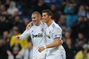 Cristiano Ronaldo, right, of Real Madrid celebrates with Karim Benzema after scoring against Levante in the first leg round of 16 Copa del Rey match between Real Madrid and Levante at Estadio Santiago Bernabeu on December 22, 2010 in Madrid, Spain.