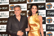 Lawyer Amal Clooney (R) and actor George Clooney (L) attends the Tokyo premiere of