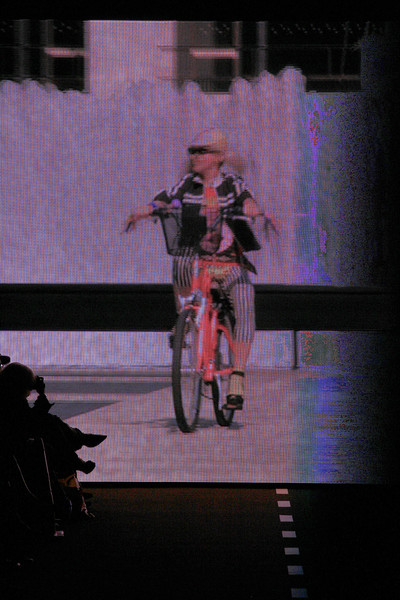 Betsey Johnson at New York Spring 2011 [bicycle,performance,vehicle,recreation,cycling,stage,performing arts,sports equipment,cycle sport,bmx bike,bicycle,vehicle,betsey johnson,recreation,meter,light,purple,performance,space,new york fashion week,bicycle,light,purple,recreation,meter,space]