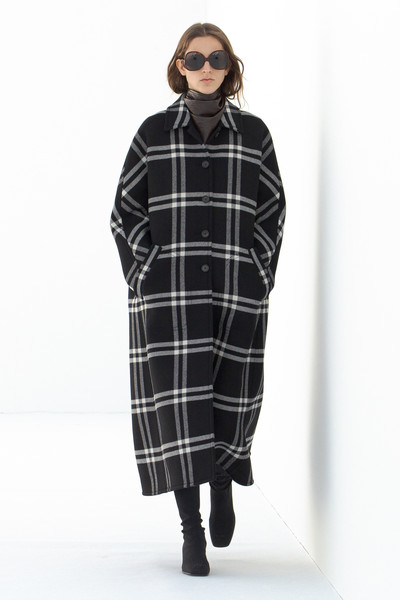 Courreges at Paris Fall 2021 [clothing,footwear,outerwear,hairstyle,tartan,neck,street fashion,eyewear,sleeve,waist,footwear,courreges,tartan,sleeve,sleeve m,coat,design,clothing,street fashion,paris fashion week,tartan,overcoat,sleeve m,coat,design,sleeve]