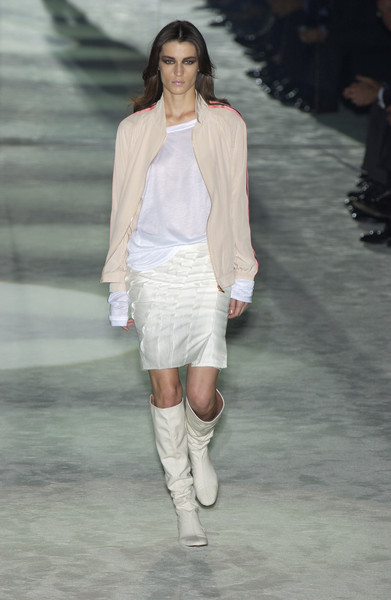 Gucci at Milan Spring 2004 [fashion show,fashion model,fashion,runway,white,clothing,shoulder,knee,public event,footwear,shoe,shoe,fashion,runway,white,clothing,shoulder,gucci,milan fashion week,fashion show,fashion,runway,gucci,shoe,fashion show,satin,corset,high-heeled shoe,made in italy]