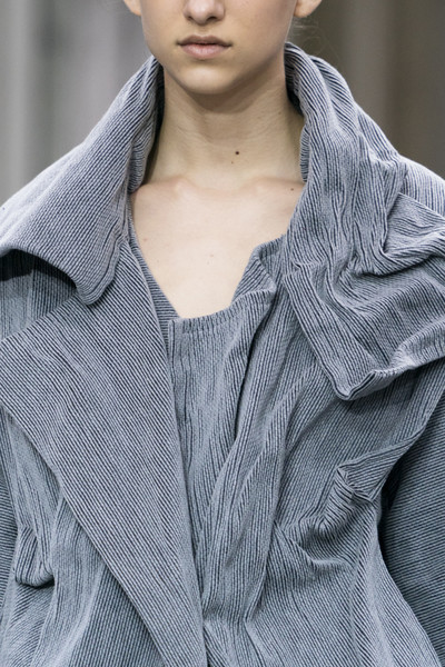 Issey Miyake at Paris Fall 2019 (Details) [clothing,fashion,neck,outerwear,beauty,skin,sleeve,lip,collar,model,collar,outerwear,issey miyake,fashion,model,clothing,neck,sleeve,lip,paris fashion week,fashion,model]