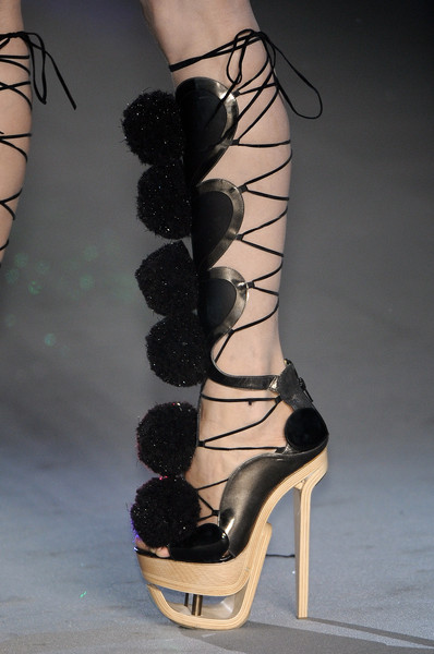 John Galliano at Paris Fall 2009 (Details) [high heels,footwear,black,shoe,leg,ankle,fashion,joint,sandal,human leg,shoe,footwear,shoes,fashion,stiletto heel,heel,heel,boot,sandal,paris fashion week,high-heeled shoe,shoe,stiletto heel,boot,sandal,footwear,fashion,heel,heel,high shoes]