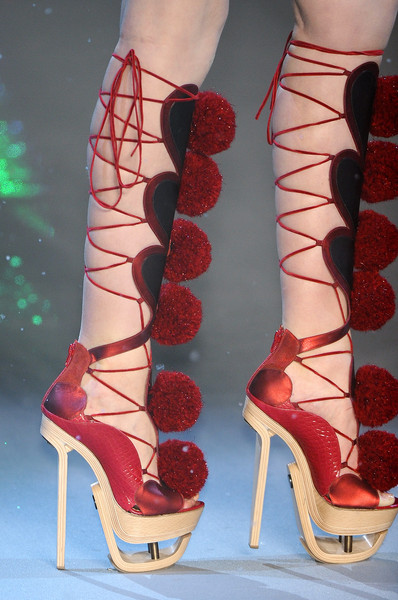 John Galliano at Paris Fall 2009 (Details) [high heels,footwear,red,shoe,leg,sandal,fashion,ankle,human leg,joint,shoe,fashion accessory,shoe,john galliano,fashion,pom-pom,stiletto heel,boot,sandal,paris fashion week,high-heeled shoe,shoe,boot,fashion,sandal,pom-pom,stiletto heel,fashion accessory,footwear]