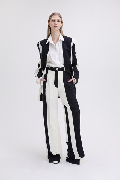 Loring New York at New York Fall 2021 [trousers,shoe,leg,dress shirt,neck,sleeve,waist,collar,pantsuit,blazer,blazer,bikini top,trousers,fashion,coat,costume,neck,new york,loring,new york fashion week,fashion,coat,blazer,costume,ready-to-wear,dos gardenias stein square neck bralette bikini top,tuxedo m.,autumn,womens wear daily]