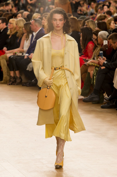 Nina Ricci at Paris Fall 2017 [fashion,fashion model,fashion show,runway,yellow,shoulder,event,outerwear,haute couture,public event,nina ricci,guillaume henry,thierry mugler,fashion,runway,yellow,shoulder,paris fashion week,fashion show,event,nina ricci,guillaume henry,paris fashion week,fashion,thierry mugler,fashion show,ready-to-wear,autumn]