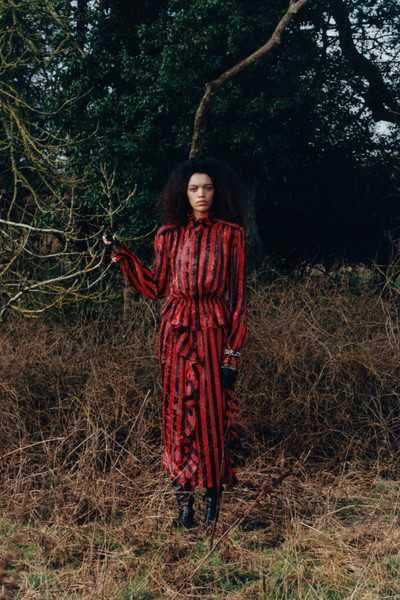 Preen at London Fall 2021 [photograph,outerwear,plant,people in nature,tree,one-piece garment,sleeve,dress,street fashion,grass,wood,dress,outerwear,people,preen,tree,grasses,nature,plant,london fashion week,dress,autumn,preen,tree,grasses,forest,2021,photograph]
