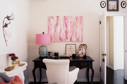 Pink accents in a corner office area