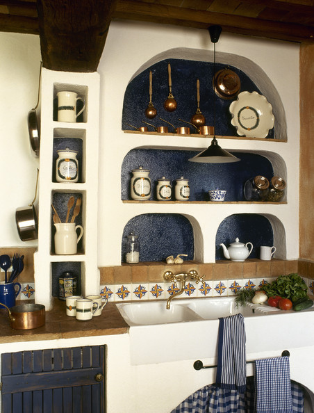 Rustic Country Kitchen Detail With Curving Niche Shelving Over A Double Sink
