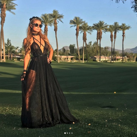 In An Edgy Black Maxi Dress On The Road To 'Chella