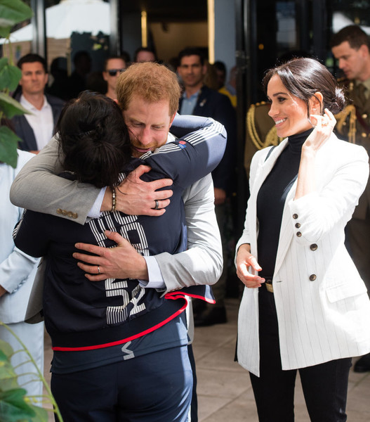 Prince Harry Gives A Hug