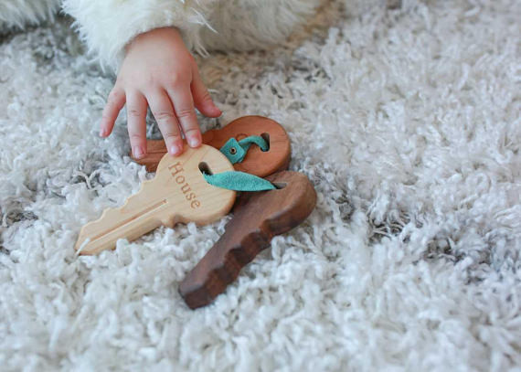 Let baby play with wooden keys