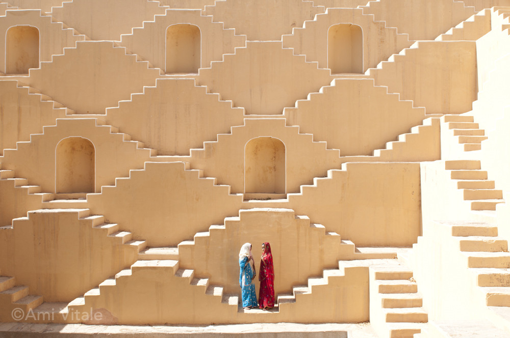 """""""Women stand in an ancient step well in Rajasthan, India.Women and girls are the primary providers of water, and often spend hours each day hauling water from distant sources."""" Ami Vitale"""