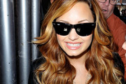 Demi Lovato rocks a pair of Ray Bans as she greets fans before an appearance on SiriusXM Radio in NYC. Lovato, who checked into a treatment center last year, chronicled her ongoing struggles with an eating disorder and self harm on an MTV special that aired this week.