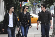 Joe and Nick Jonas are joined by a friend for lunch in West Hollywood. The trendy trio shared a giggle as they strolled down the sidewalk.