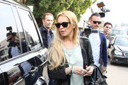 Lindsay Lohan garners a lot of attention as she leaves a sushi restaurant  and walks back to her black Range Rover. The actress, who recently purchased a beach home in Venice next to ex-girlfriend Samantha Ronson, was seen on a business date earlier today with Pascal Mouawad, a famed jeweler. Lohan recently tweeted, 'Thanks @Trevkgimotors and Amber at Germanindependent.org for the ONYX range rover' which she is seen getting into.