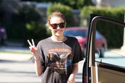 Wednesday February 3, 2011.Ê.Miley Cyrus, dressed in skinny, acid wash jeans and a Harley Davidson t-shirt, flashes a smile and the peace sign for photographers. It is being reported that Cyrus has gotten a new tattoo on the right side of her rib cage, the first legal one since being 18.